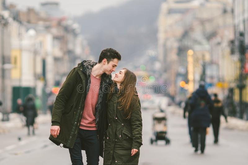 Young couple, heterosexual boy and girl of Caucasian nationality, loving couple, walk around the center of country of European. City in the middle of road on royalty free stock photography