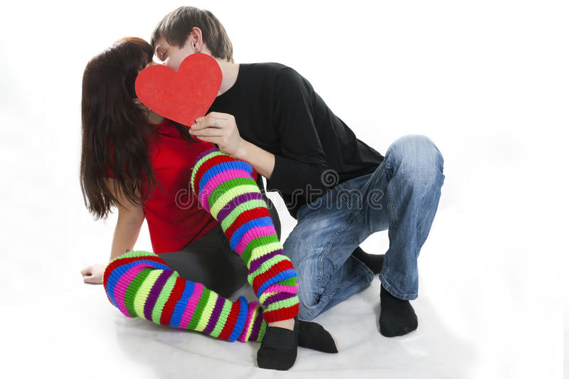 Download Young Couple Hiding Their Kiss By Red Heart Stock Image - Image: 18267081