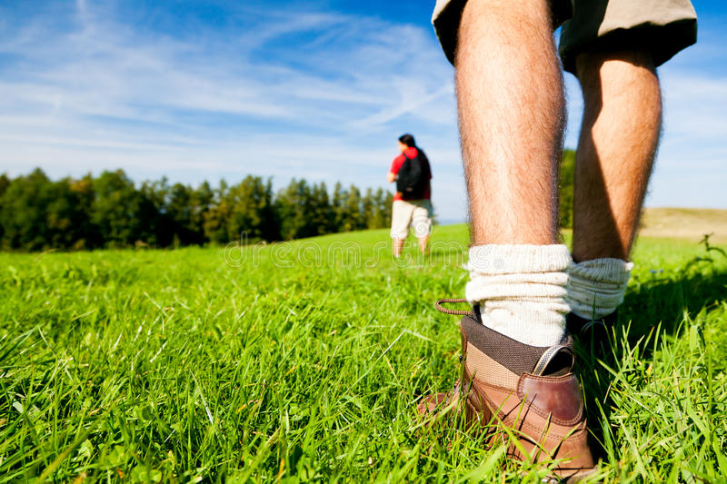 Young Couple Hiking. Outdoors in summer, focus on feet stock images