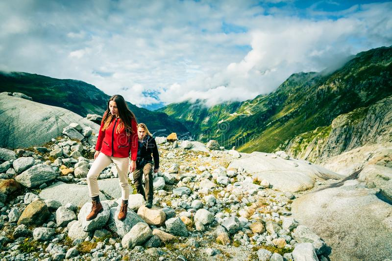 Young Couple Hiking In The Swiss Alps stock photos