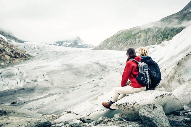 Young couple hiking in the swiss alps, taking a break stock image