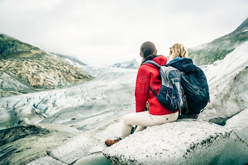 Young Couple Hiking In The Swiss Alps, Taking A Break royalty free stock images