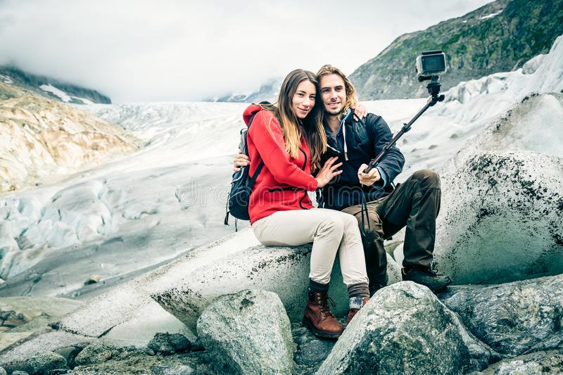 Young Couple Hiking In The Swiss Alps, Taking A Selfie royalty free stock photography
