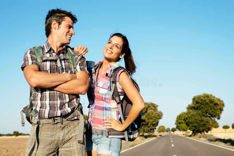 Young couple on hiking travel royalty free stock photo