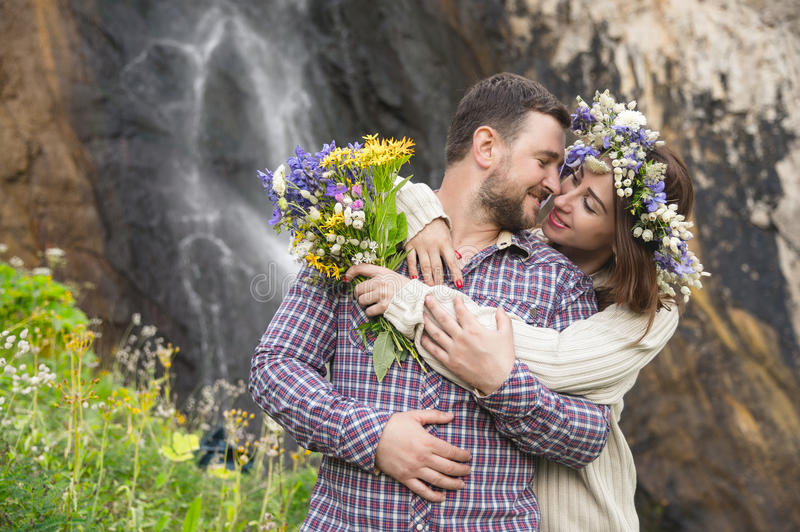 Young couple hipster hugging in nature stock photos