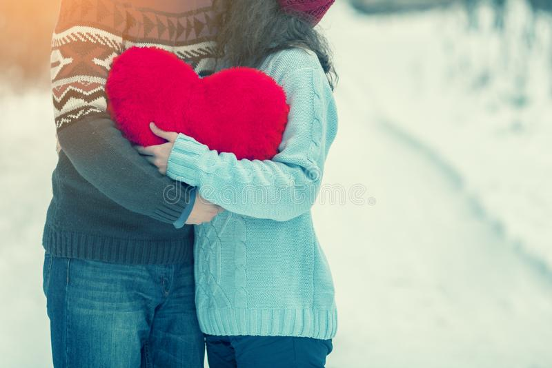 Young couple holding big red heart royalty free stock photo