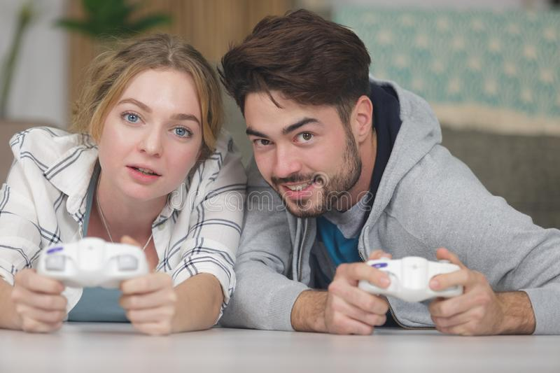 Young couple holding games console controls royalty free stock photography