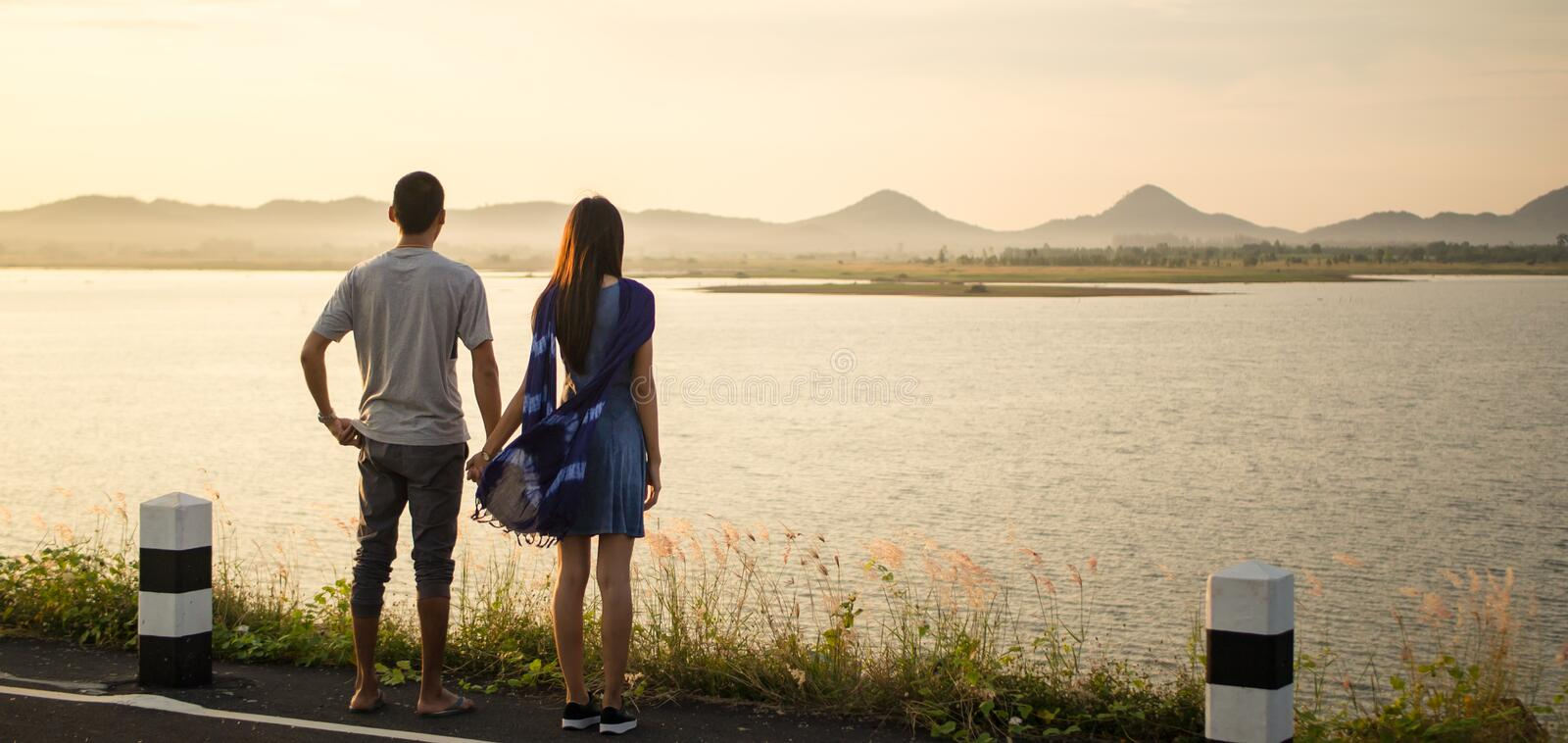 Young couple holding hand and see beautiful landscape stock photo