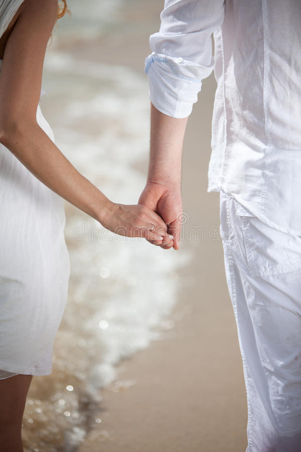 Download Young couple holding hands stock image. Image of groom - 22226933