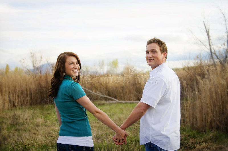 Young Couple Holding Hands royalty free stock images