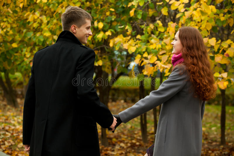 Young couple holding hands gently stock photography