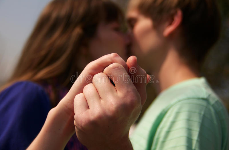 Young couple holding hands together royalty free stock images