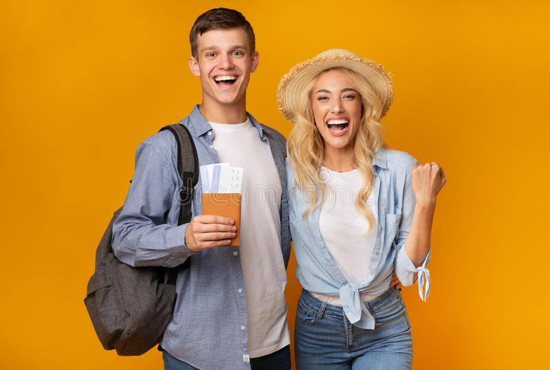 Young couple holding passports and tickets excited about future vacation stock image