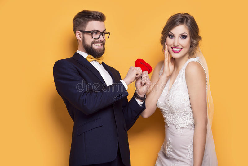 Young couple holding red heart royalty free stock images