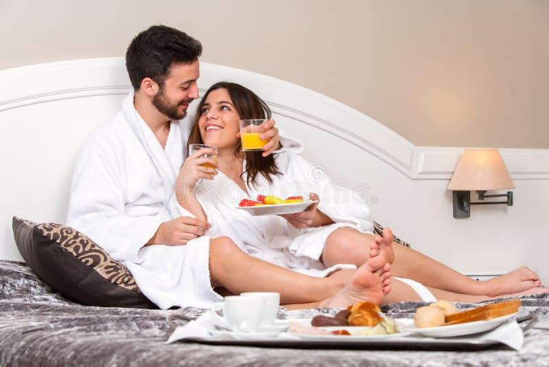 Young couple on honeymoon in hotel room. stock photo