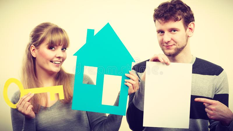 Young couple with house and paper stock photography