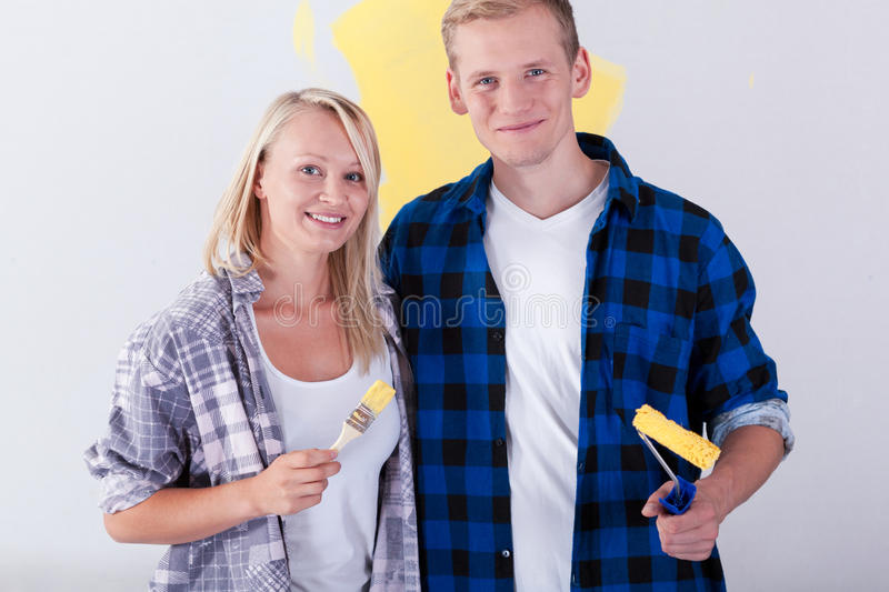Young couple during house renovation. Smiling young couple during house renovation royalty free stock images
