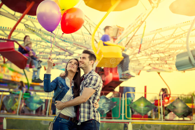 Young couple hugging in amusement park royalty free stock photo