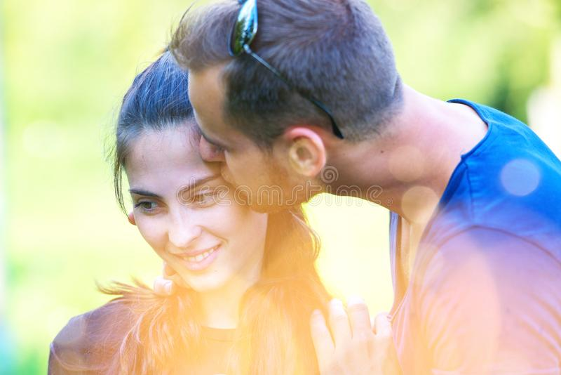Young couple having fun together. Young couple hugging and having fun in summer time. men kissing woman royalty free stock photo