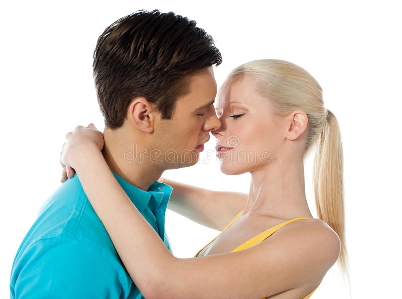 Young Couple Hugging And Kissing Stock Photo