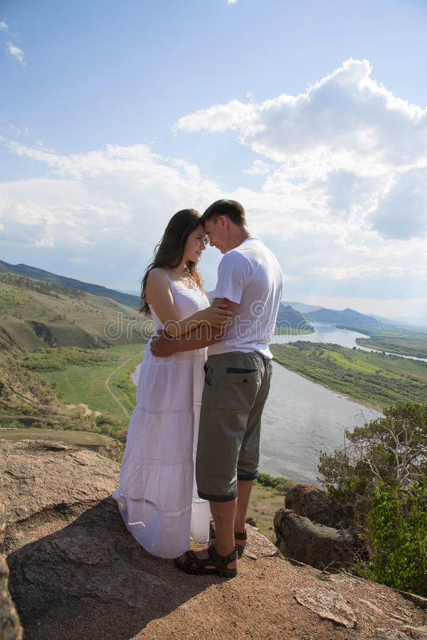 Download Young Couple Hugging In Mountains Stock Photo - Image: 31896922