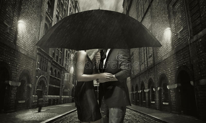 Young couple hugging in the rain royalty free stock photos