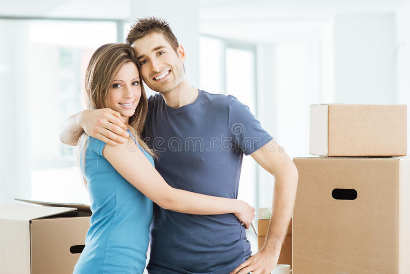 Young couple hugging in their new house royalty free stock photo
