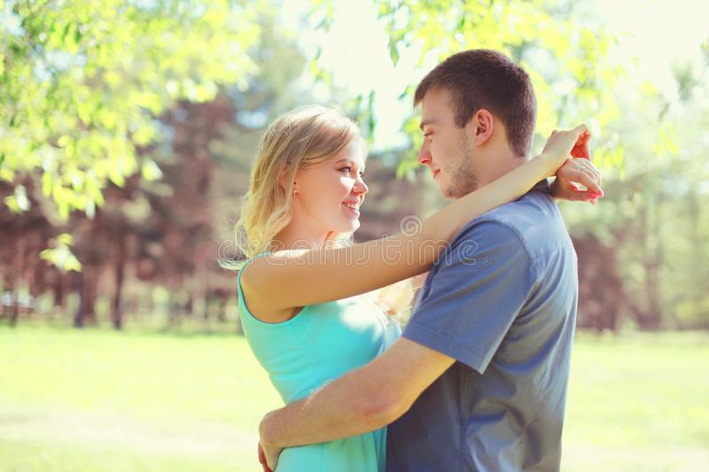 Young couple hugs at sunny spring day together. Happy young couple hugs at sunny spring day stock image