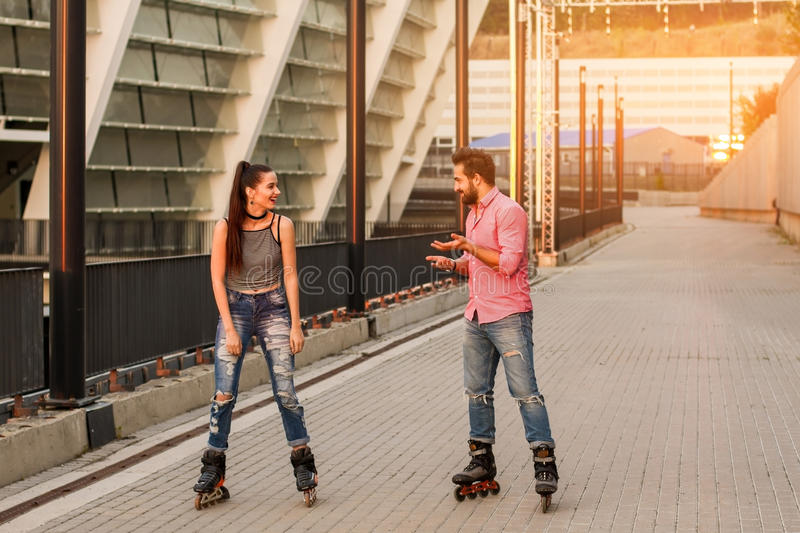 Young couple inline skating. royalty free stock images
