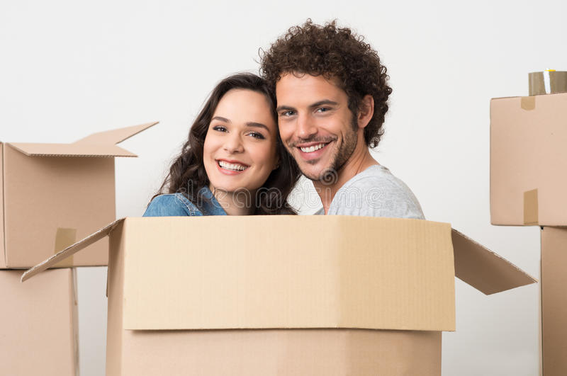 Young Couple Inside Cardboard Box royalty free stock photography