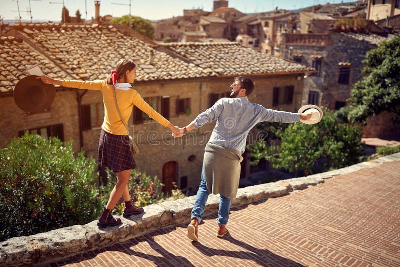 Young couple at the Italy - tourists couple visiting Toscana stock image
