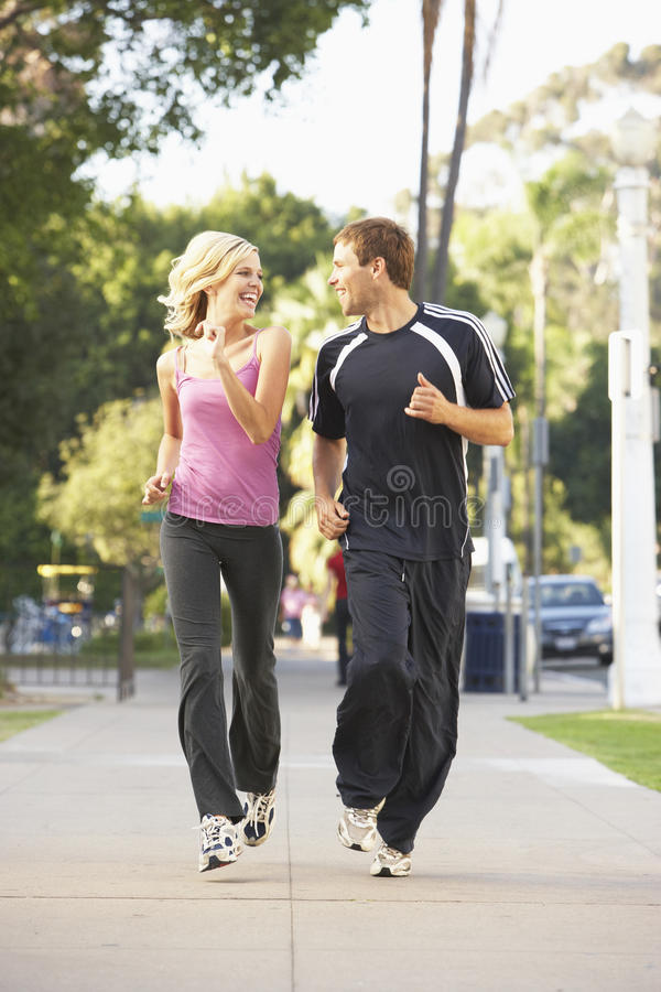 Free Young Couple Jogging On Street Royalty Free Stock Images - 11502889