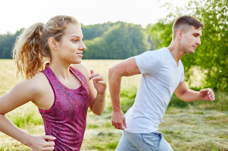 Young couple jogging at park stock image