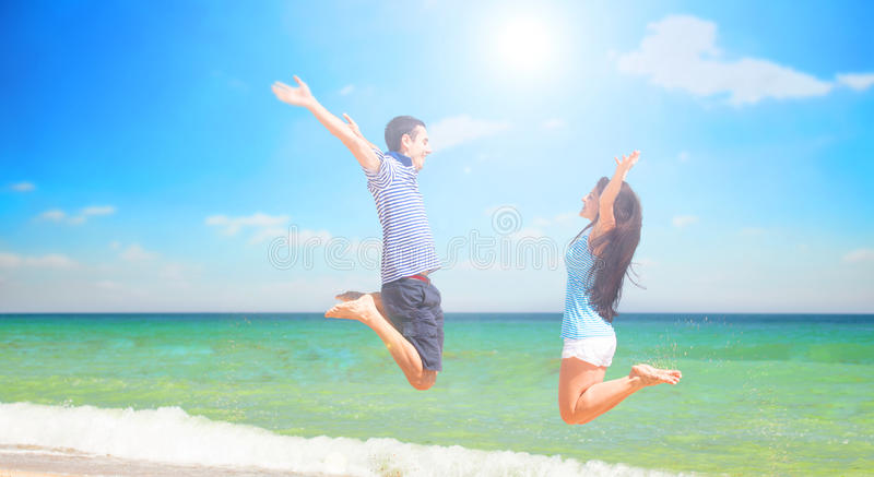 Young Couple Jumping Stock Photo