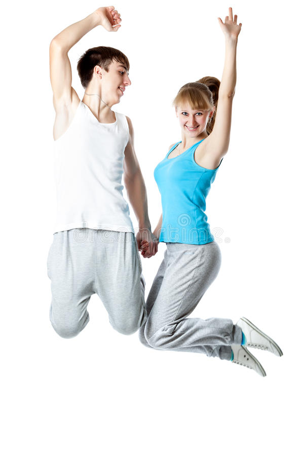 The Young Couple Is Jumping In A Studio Stock Image
