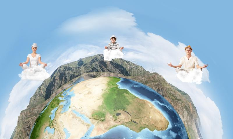 Young family keeping mind conscious. Young couple keeping eyes closed and looking concentrated while meditating on clouds in the air with panoramic view of stock illustration