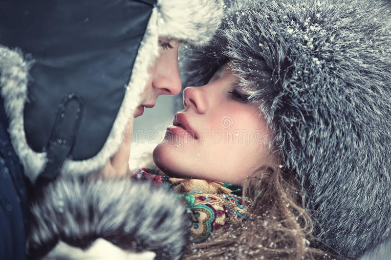 Young couple kissing. Young kissing couple outdoors portrait