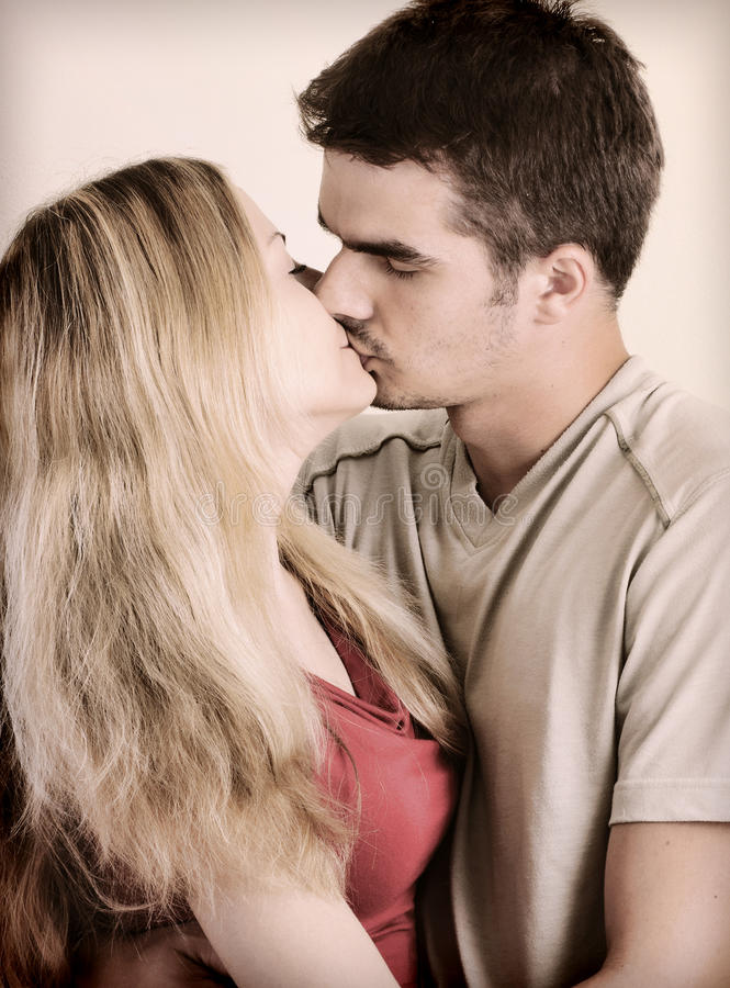 Young couple kissing royalty free stock photography