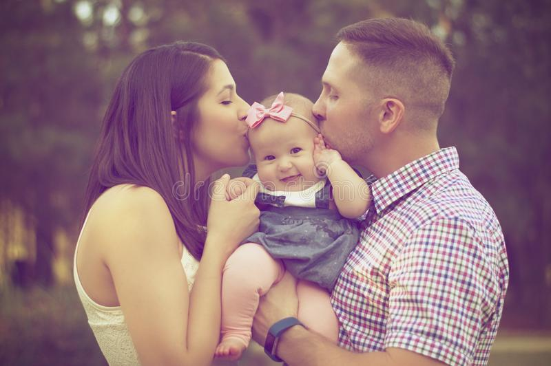 Young Couple Kissing Baby Girl Free Public Domain Cc0 Image