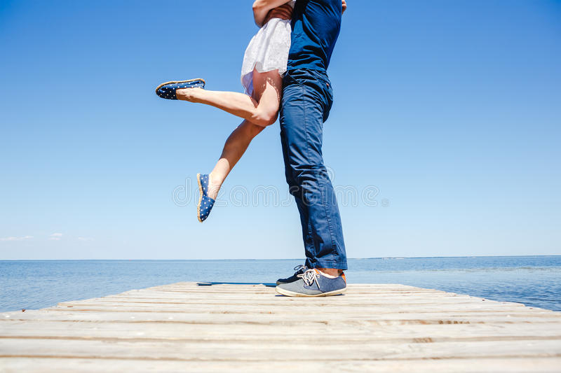 Young couple kissing on the beach stock photography