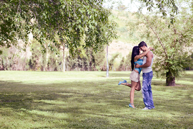 Young Couple Kissing In A Beautiful Park Stock Image