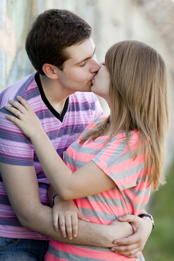 Download Young Couple Kissing Near Graffiti Background. Stock Photo - Image: 24606538