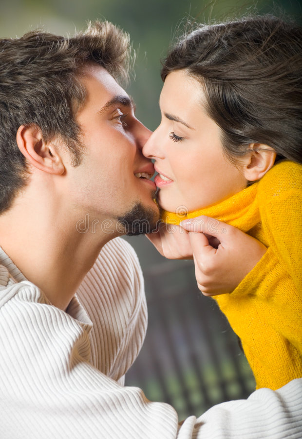 Young couple kissing outdoor royalty free stock photos