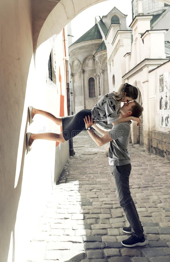 Young couple in love, kissing in the old part of town royalty free stock photo