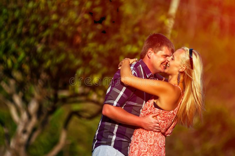 Young couple kissing in the tropics. On a hot summer day royalty free stock images