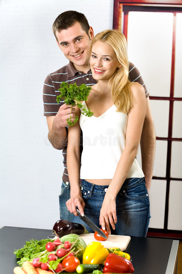 Download Young Couple At The Kitchen Stock Image - Image: 2351021