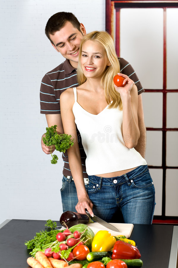Download Young Couple At The Kitchen Stock Image - Image of happy, couple: 2351031