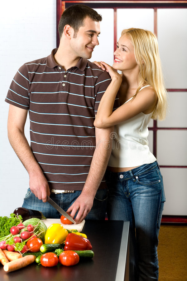 Young couple at the kitchen stock photo