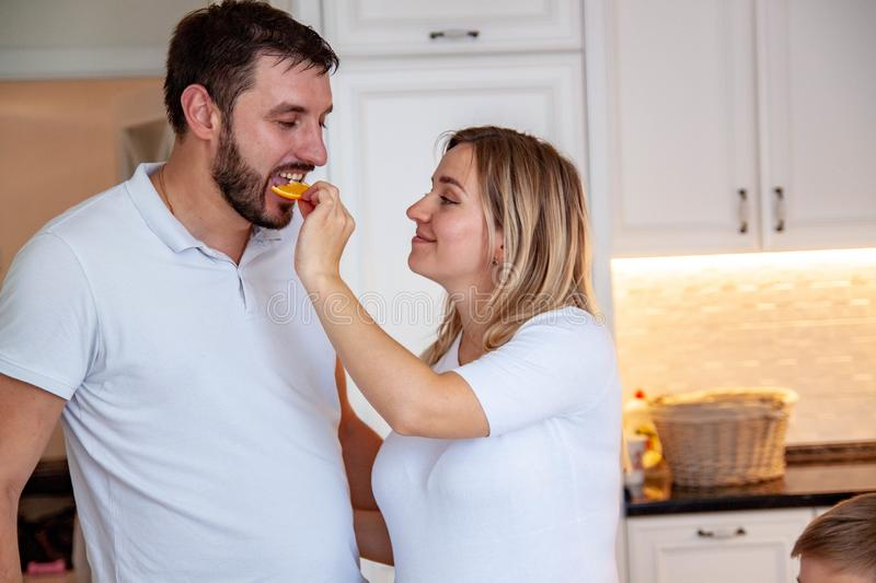 Young couple in kitchen, portrait. royalty free stock photo