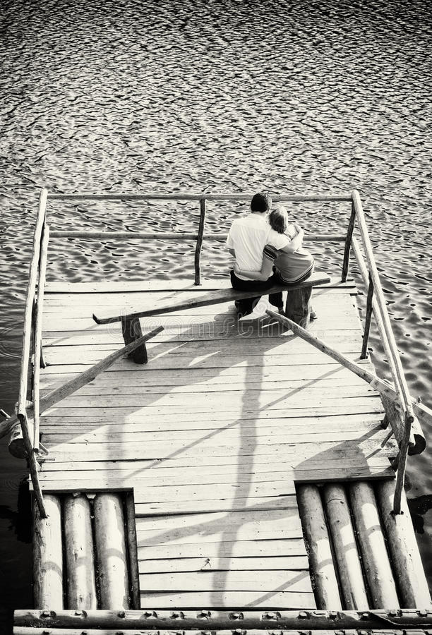 Young couple on the lake royalty free stock photography